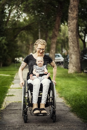 a paraplegic mom carrying her baby