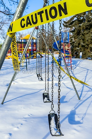a playground cordoned off with caution