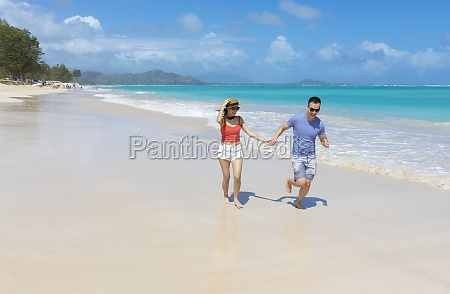 an asian couple enjoying a vacation