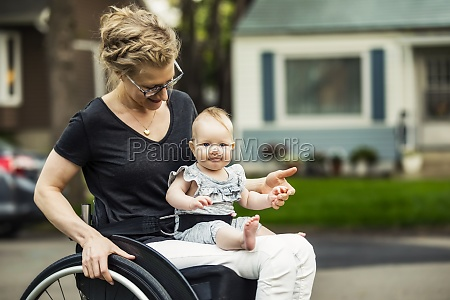 a, paraplegic, mom, carrying, her, baby - 29679172