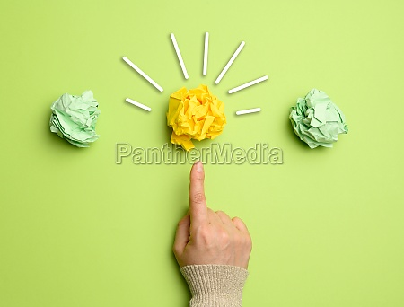 female hand points finger at yellow