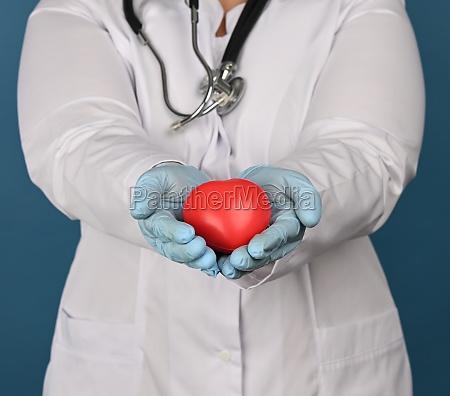 female medic in a white coat