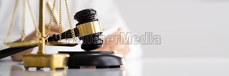 judge with gavel and law scale
