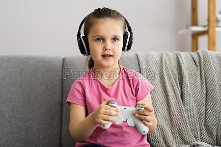 addictive child kid gamer playing video