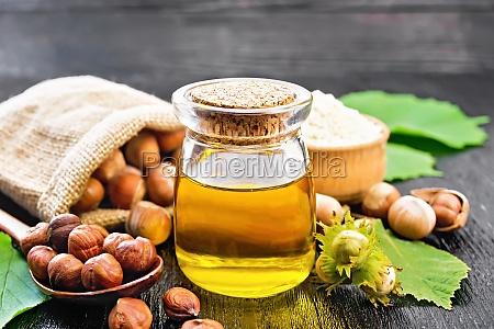oil hazelnut in jar on wooden