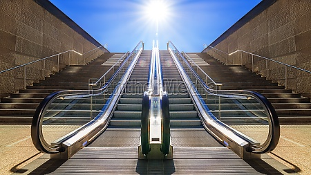 modern escalator against a sunny blue