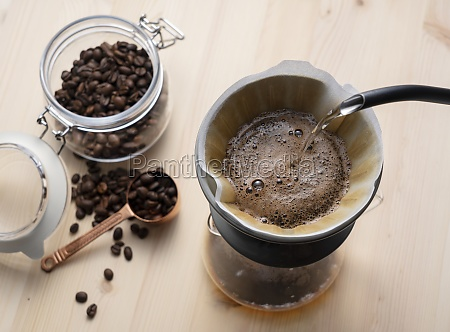 pour hot water over the coffee