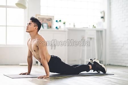 muscular asian young man doing