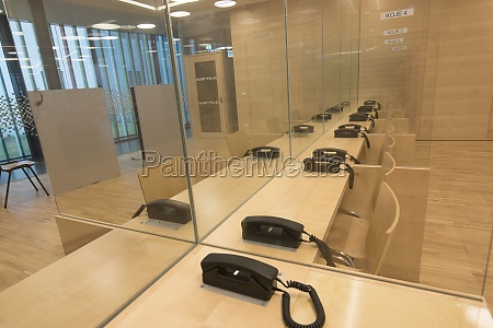 transparent dividing walls with telephones