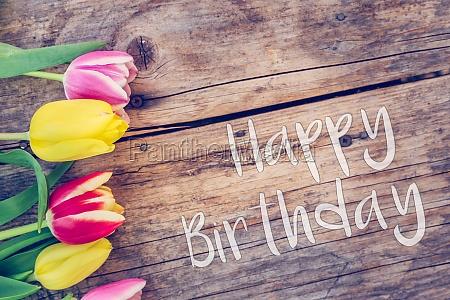 happy birthday arrangement of colorful tulips
