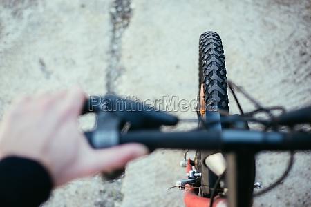 mountain bike tyres outside blurry handlebar
