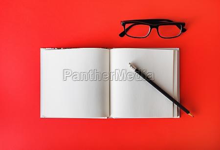 blank brochure pencil glasses