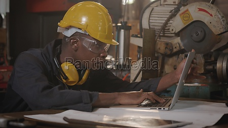 worker man with yellow helmet and