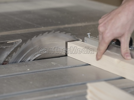 sawing wood in a joinery or