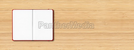 red open lined notebook isolated on
