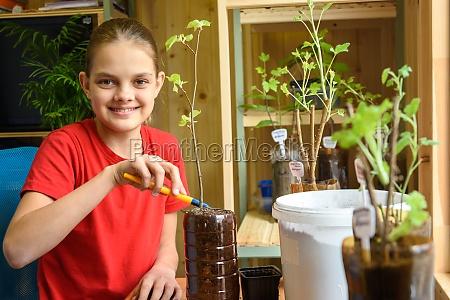 happy girl transplants garden plants and