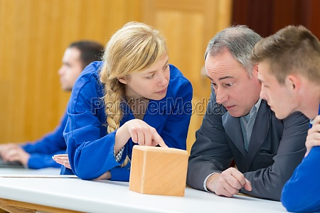 female student asking question in woodwork