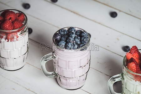blueberries with yogurt in a glass