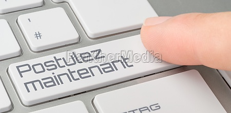 a keyboard with a labeled button