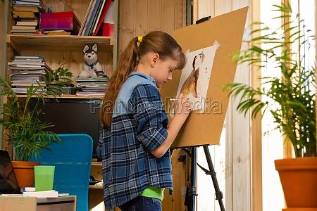 girl draws a cat on an