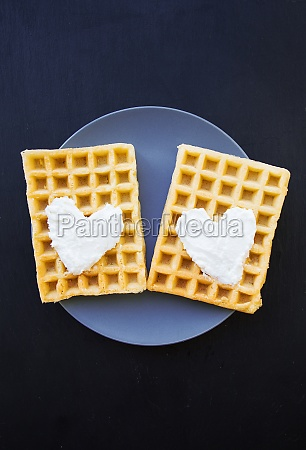 delicious belgian waffles with cream on