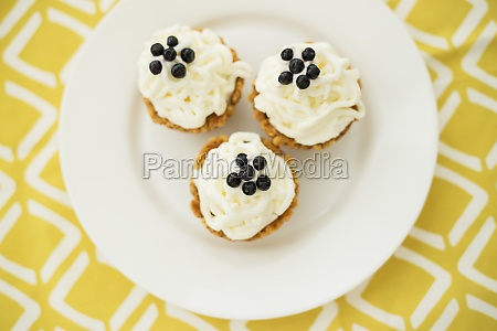 homemade muffins with blueberries cream and