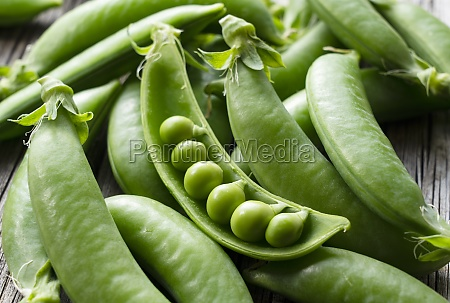 snap peas on an old wooden