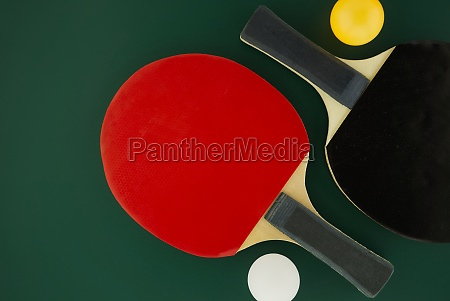 two table tennis racks with ping