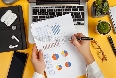 business woman hands writing on report