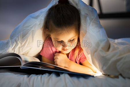 little child reading book with fairy