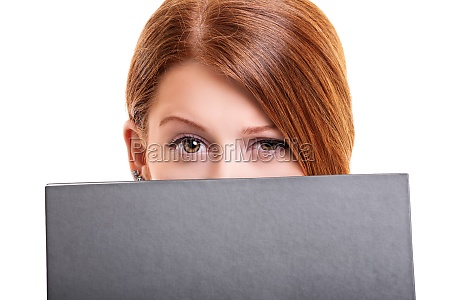 young woman hiding her face behind