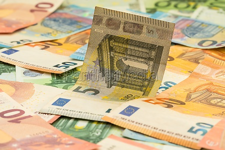 euro banknotes scattered around
