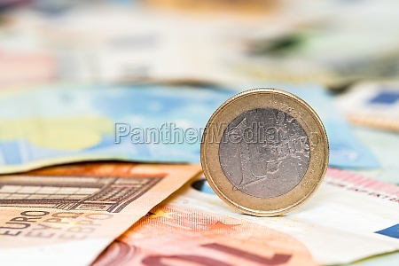 one euro coin and bills of