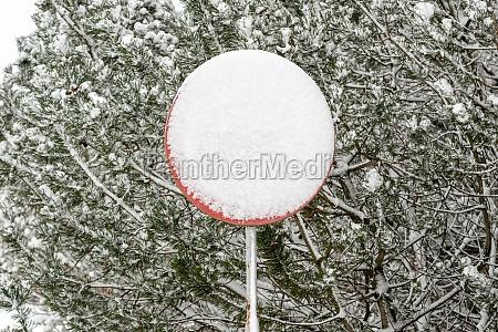 road sign after snowstorm