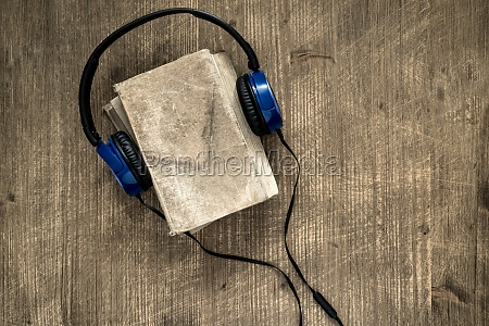 old book and headphones
