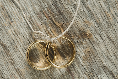 wedding concept with rings on string