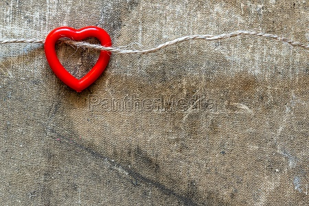 plastic heart hanging on the string