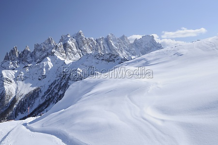 snowy slope and pale range dolomites
