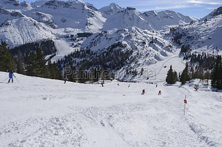 steep ski run with heavy snow