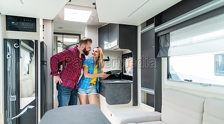woman and man testing interior of