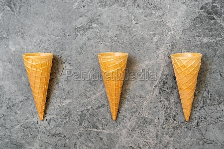 three wafer cones on stone background