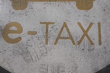 e taxi sign on the street