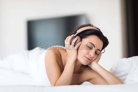 pretty young woman listening to music