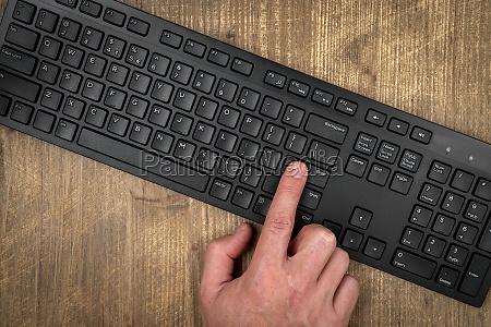 finger on the enter key