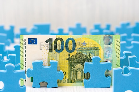 one hundred euro surrounded by puzzle