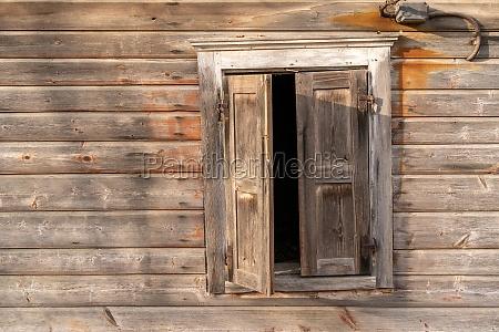 abandoned wooden log house