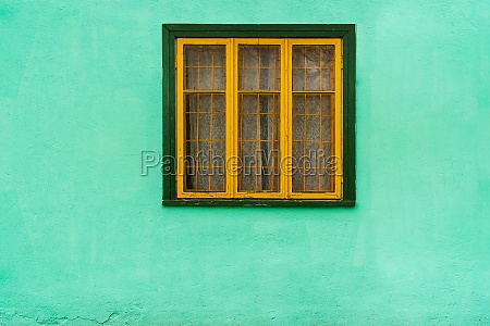 yellow window with bars on blue
