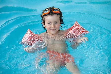 cute child playing in the swimmingpool