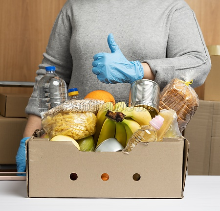 woman in gloves keeps collecting food