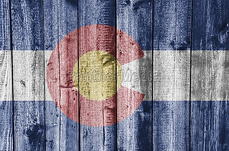 flag of colorado on old wooden